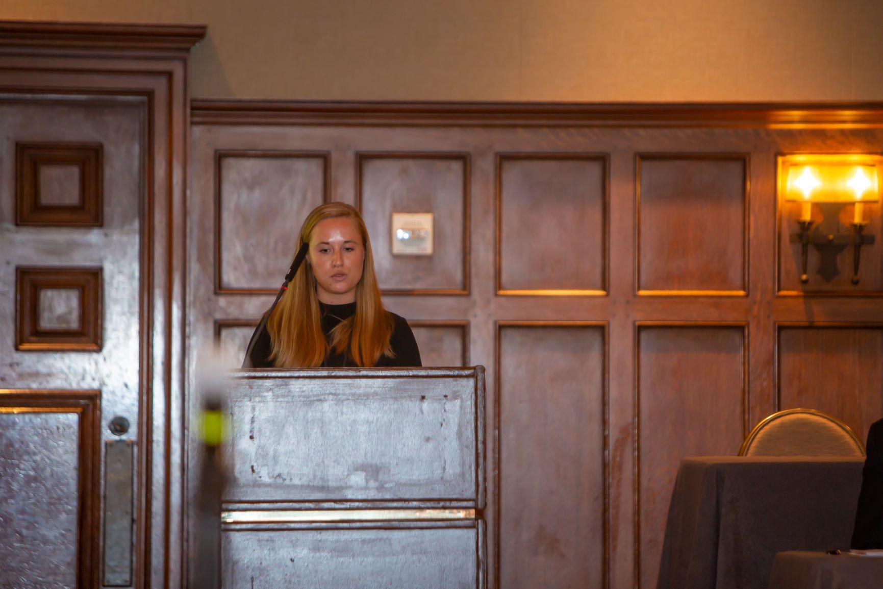 medical student at podium